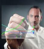 Virtual Diagram. Close-up of mature man writing on virtual screen (shot on PhaseOne 45 Royalty Free Stock Photos