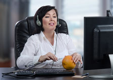 Virtual doctor explains subcutaneous injection technique with grapefruit Stock Photo