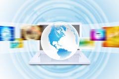 Virtual Earth on white laptop Royalty Free Stock Photos