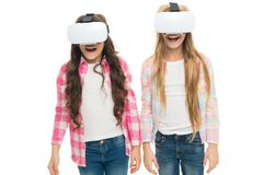 Virtual education. Kids wear hmd explore virtual or augmented reality. Future technology. Girls interact cyber reality. Play cyber game and study. Modern royalty free stock image