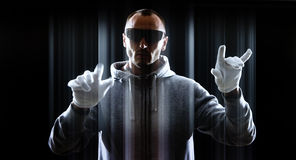 Virtual futuristic thief in gloves Royalty Free Stock Photo