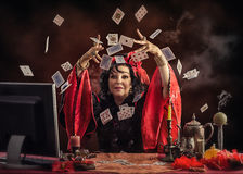 Virtual Gypsy clairvoyant tossing up cards Royalty Free Stock Photos