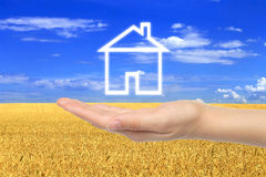 Virtual house with woman hand Royalty Free Stock Photo