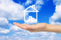 Virtual house with woman hand Stock Image