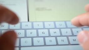 Virtual keyboard on touchscreen of iPad stock video footage