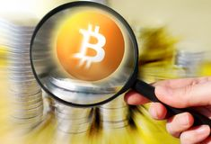 Virtual money Bitcoin cryptocurrency - Bitcoins accepted here. Czech crown coins and Bitcoin with magnifying lens stock photos