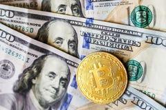 Virtual money golden bitcoin on hundred dollars bills background. Exchange bitcoin cash for a dollar stock image