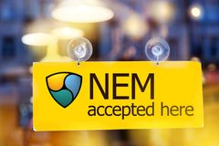Virtual money NEM cryptocurrency - NEM XEM currency accepted h stock photos