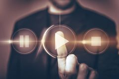 Virtual Music Play and Listen. Music Listening Concept Illustration with Men Touching Virtual Play Button By His Finger stock photo