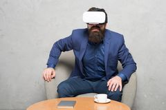 Virtual office and work space. Businessman sit chair wear hmd explore virtual reality or ar. Business partner interact. In virtual reality. New opportunity stock photography