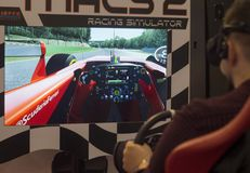 Virtual racing simulator. Man play the video game with virtual reality device in this context, virtual reality concerns a racing car race. photo taken at enada royalty free stock photography
