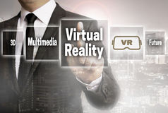 Virtual reality businessman with city background concept Royalty Free Stock Photo