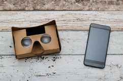 Virtual reality cardboard glasses. Easy way to watch movies in 3D Royalty Free Stock Photo