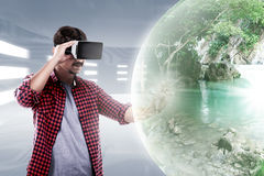 Virtual Reality Conceptual Images. Young asian man wear VR headset get into virtual reality world stock photo