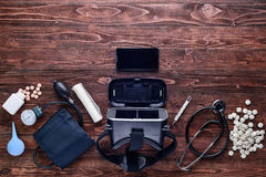 Virtual reality device,pills and some medical equipment.Top view Royalty Free Stock Photos