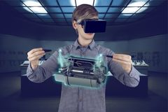 Engineer / architect workplace. Virtual reality in engineering concept. Male / man engineer wearing shirt and vr glasses fixing holographic engine for mechanic Royalty Free Stock Images
