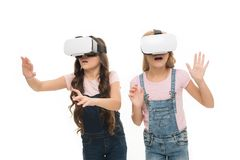 Virtual reality is exciting. Girls little kids wear vr glasses white background. Virtual education concept. Modern life royalty free stock photography