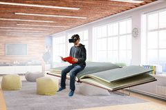Virtual reality experience, young man in VR glasses. Mixed media stock photos