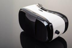 Virtual reality glasses on black surface Stock Image