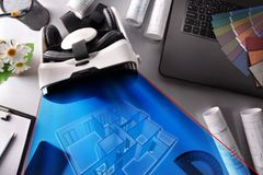 Virtual reality glasses on decorator office table wirth represen. Black and white virtual reality glasses on decorator office table with interior 3d Stock Images