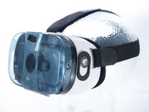 Virtual Reality Glasses on Transparent Glass Head. With white background Stock Photos