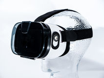 Virtual Reality Glasses on Transparent Glass Head. With white background Royalty Free Stock Photo