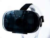 Virtual Reality Glasses on Transparent Glass Head. With white background Royalty Free Stock Photos