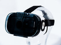 Virtual Reality Glasses on Transparent Glass Head. With white background Stock Images