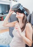 Virtual reality glasses woman home Royalty Free Stock Images
