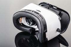 Virtual reality goggles on black surface Royalty Free Stock Images
