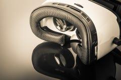 Virtual reality goggles on dark surface Royalty Free Stock Photos