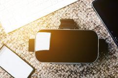 Virtual reality goggles on a table and white background. Technology background. Stock Photos