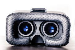 Virtual reality goggles on a table and white background. Technology background. Royalty Free Stock Photos