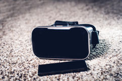 Virtual reality goggles on a table and white background. Technology background. Royalty Free Stock Photo