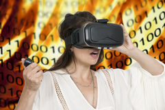 Virtual Reality Goggles. Young woman wearing a set of virtual reality goggles Royalty Free Stock Photos