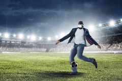Virtual Reality headset on a black male playing soccer. Mixed media royalty free stock photo