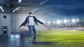 Virtual Reality headset on a black male playing soccer. Mixed media royalty free stock photos
