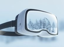 Virtual reality headset, double exposure. Mysterious winter landscape majestic mountains in the . Royalty Free Stock Images