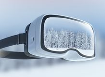 Virtual reality headset, double exposure. Mysterious winter landscape majestic mountains in the . Royalty Free Stock Image
