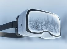 Virtual reality headset, double exposure. Mysterious winter landscape majestic mountains in the . Royalty Free Stock Photography