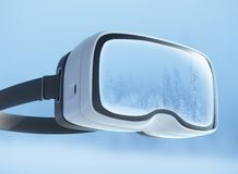 Virtual reality headset, double exposure. Mysterious winter landscape majestic mountains in the . Stock Images
