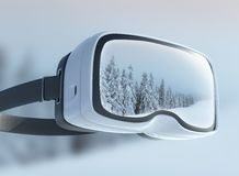 Virtual reality headset, double exposure. Mysterious winter landscape majestic mountains in the . Stock Photo