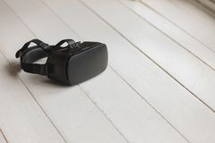 Virtual reality headset placed on the floor. Close-up of virtual reality headset placed on the floor at home stock photos