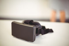 Virtual reality headset on table Stock Images
