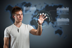 Virtual reality interface. Young man navigating holographic virtual reality interface Stock Photography