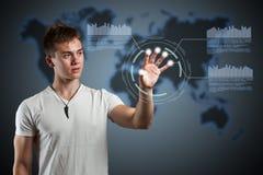 Virtual reality interface. Young man navigating holographic virtual reality interface Stock Photography