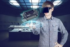 Virtual reality in mechanical concept. Virtual reality in mechanical engineering. 3d engineer in shirt looking through vr glasses at engine for heavy industry on Royalty Free Stock Image