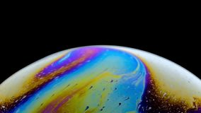 Virtual reality space with abstract multicolor psychedelic planet. Closeup Soap bubble like an alien planet on black. Background stock video footage