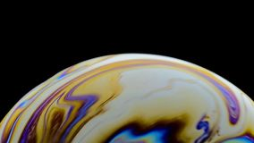 Virtual reality space with abstract multicolor psychedelic planet. Closeup Soap bubble like an alien planet on black. Background stock video