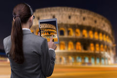 The virtual reality travel concept with woman and tablet Royalty Free Stock Photography